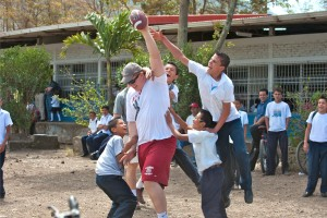 Jones plays an exciting game of football with children in Nicaragua.