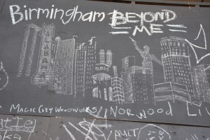 A chalk drawing of Birmingham's most distinctive sites on a wall on 3rd Avenue North.